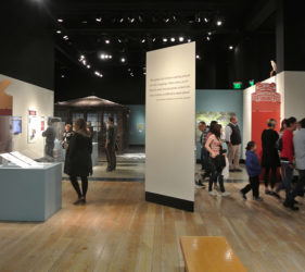 Visitors move through the exhibits