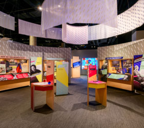 Exhibit space with color graphics and overhead banners